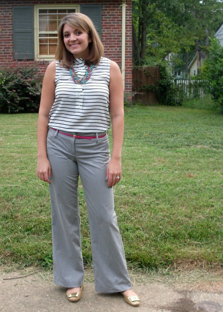 Gray pants, navy blue striped top, and pink belt