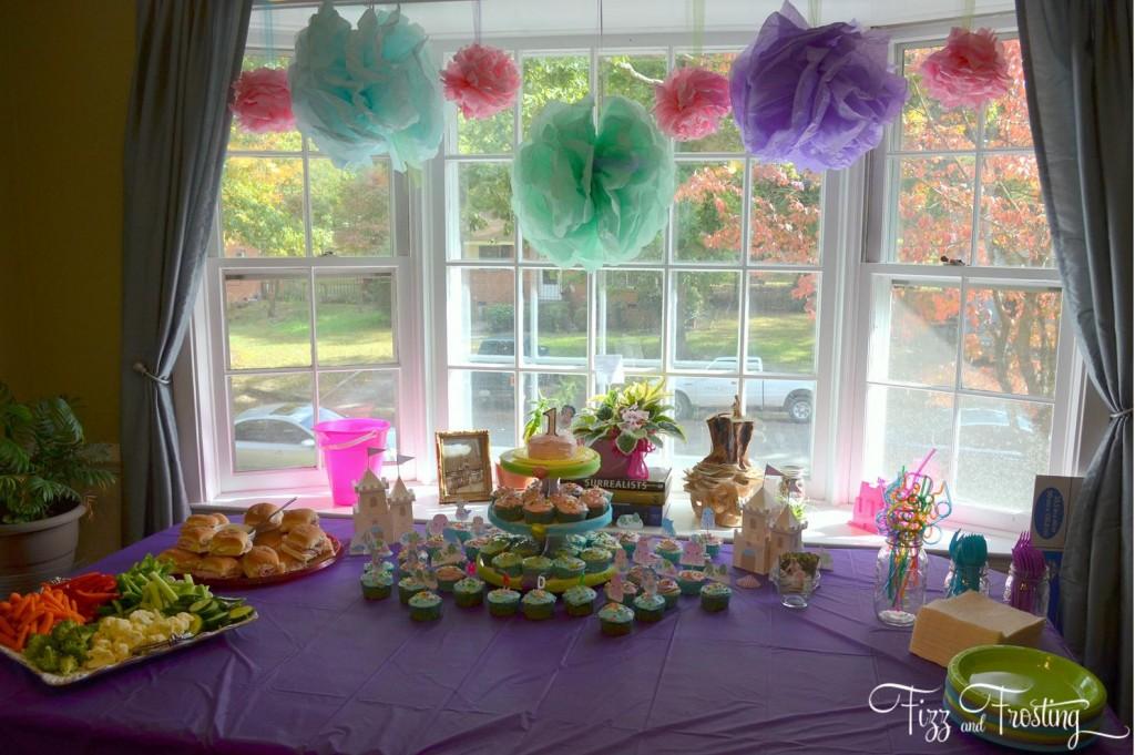Pastel girl's birthday cupcake table display