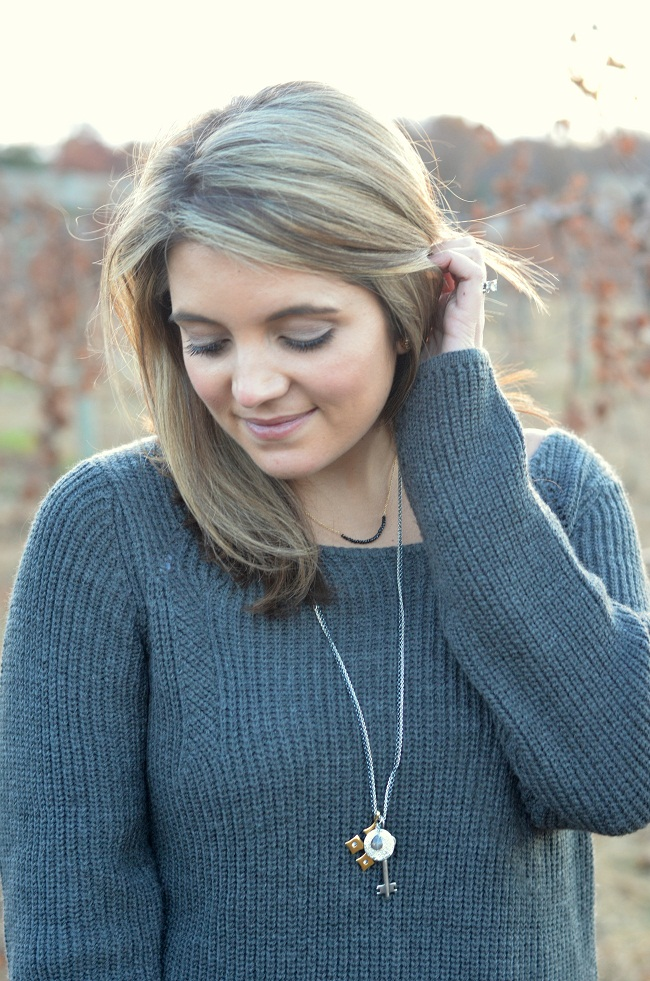 layer necklaces with sweater