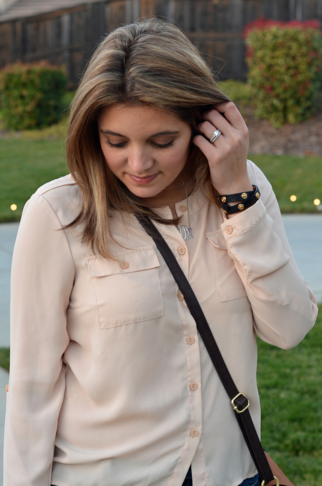 monogram silver necklace with blush blouse