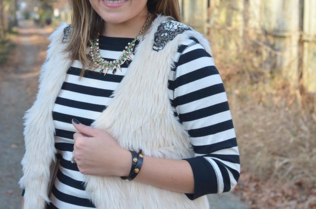 off-white fur vest with embellished shoulder