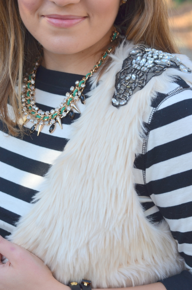 stripes with fur vest and jeweled necklace