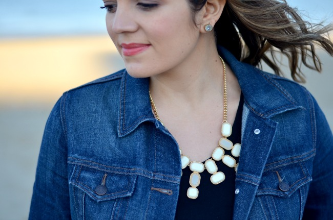 white statement necklace over black tee