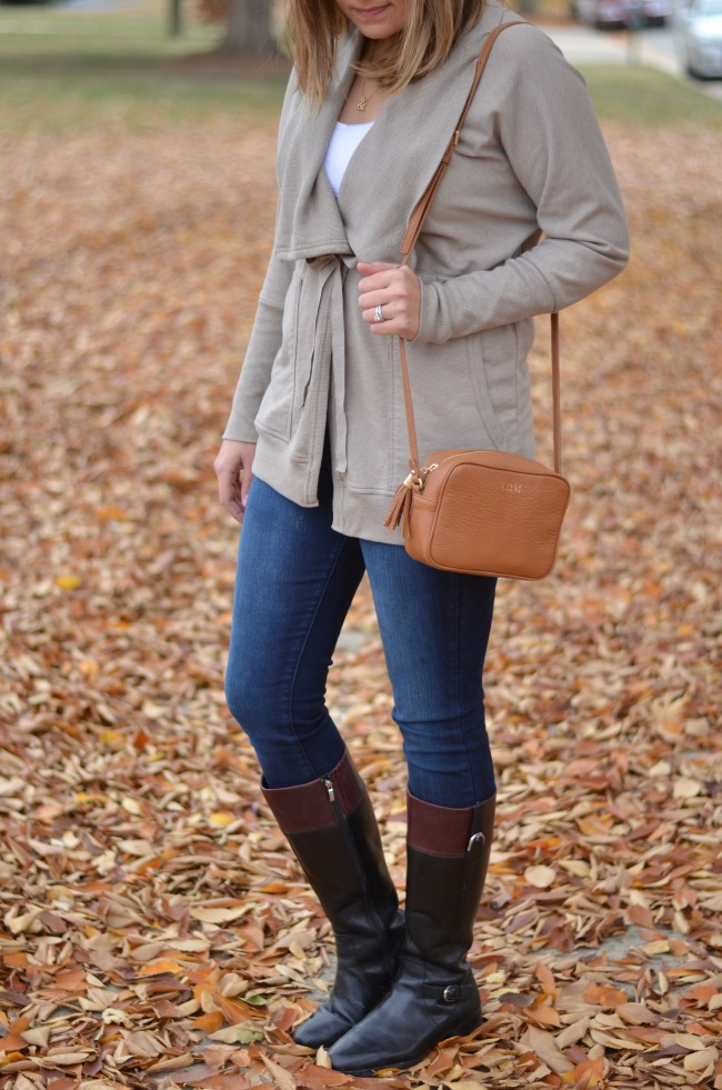 wrap jacket with jeans and boots
