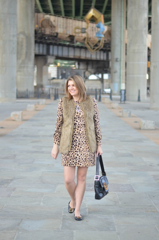 faux fur vest over dress