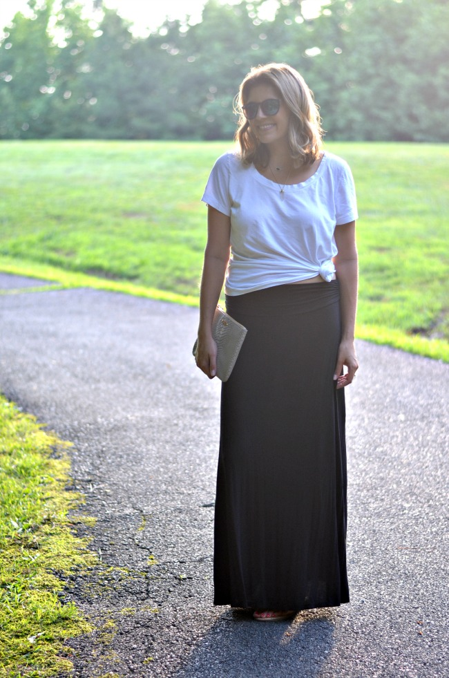 wearing a knotted tee with a maxi skirt from @fizzandfrosting