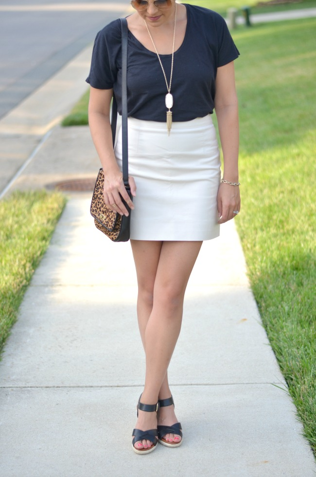 wear a mini skirt casually with a tee from @fizzandfrosting