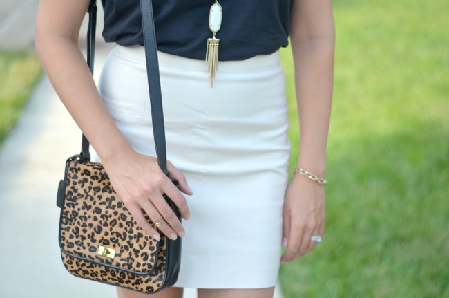 leopard print bag, cream mini skirt, kendra scott necklace