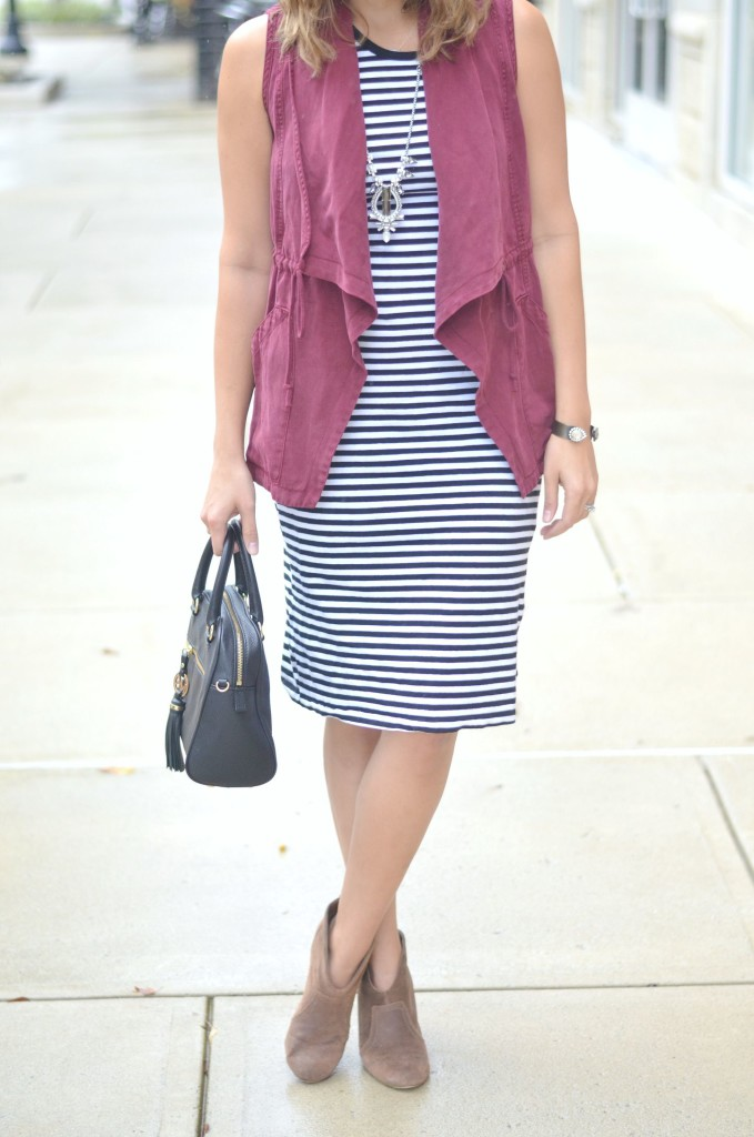 soft vest with a striped dress for fall via @fizzandfrosting