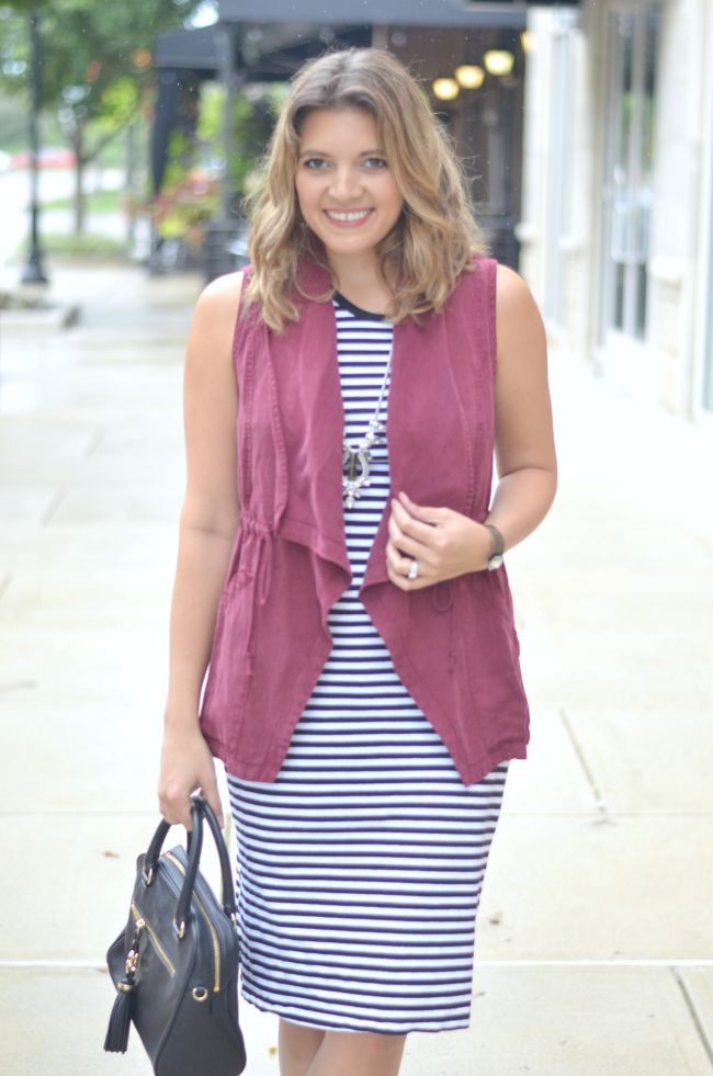 wear a dress with a vest for fall via @fizzandfrosting