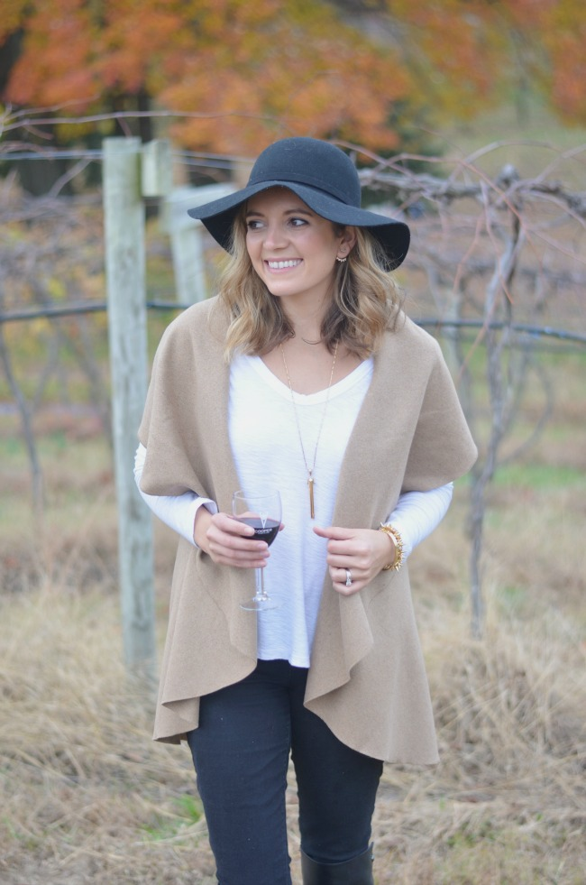 draped vest and a floppy hat via fizzandfrosting.com