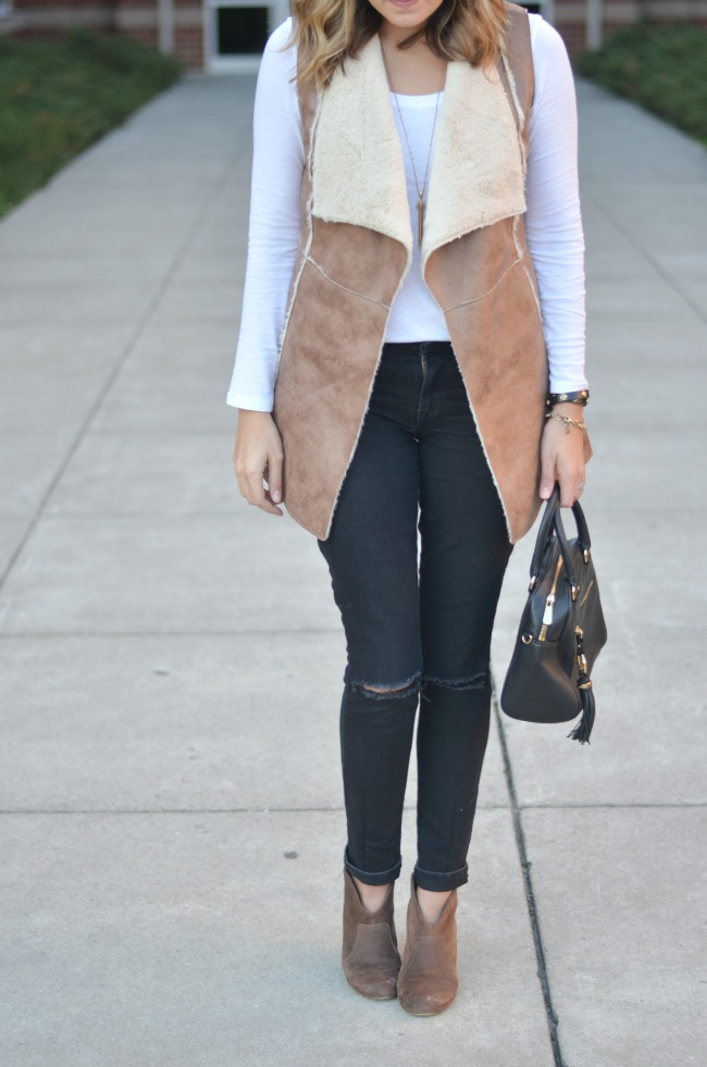 how to wear a shearling vest for fall via fizzandfrosting.com