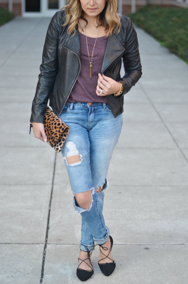 distressed jeans with a leather jacket via fizzandfrosting.com