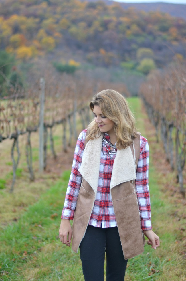 plaid for fall: layer plaid top with shearling vest via fizzandfrosting.com