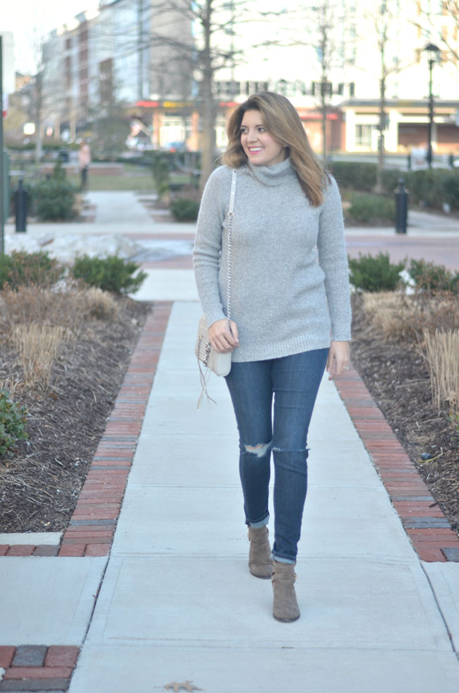 wearing shades of gray - long gray turtleneck, distressed jeans | www.fizzandfrosting.com