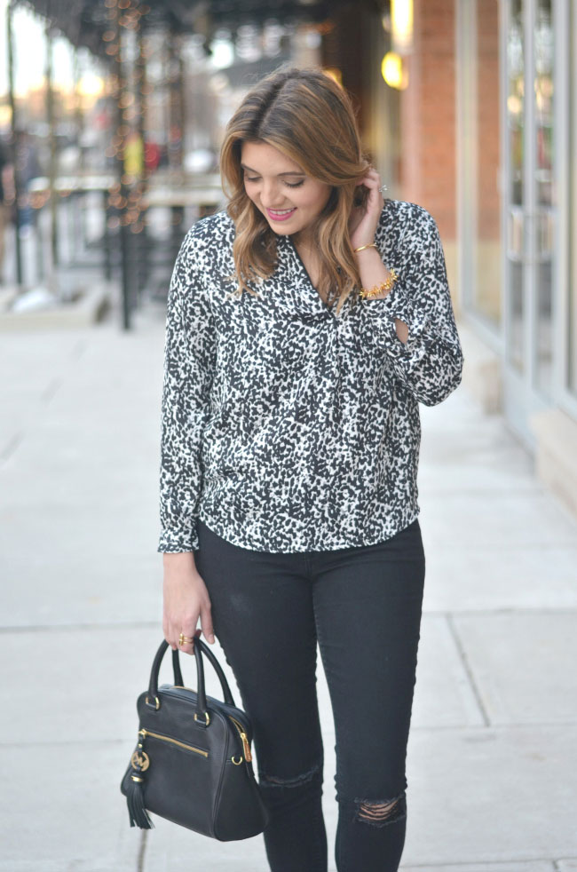 black distressed skinny jeans, animal print top via fizzandfrosting.com