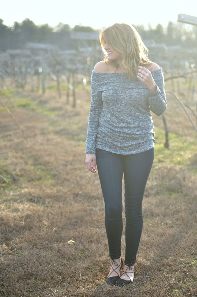chic winter outfit - off the shoulder top, skinny jeans, lace up flats via fizzandfrosting.com