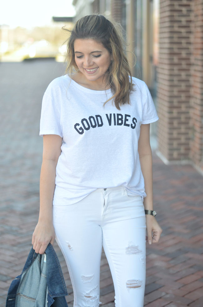 all white casual outfit - good vibes tee with distressed white jeans | www.fizzandfrosting.com