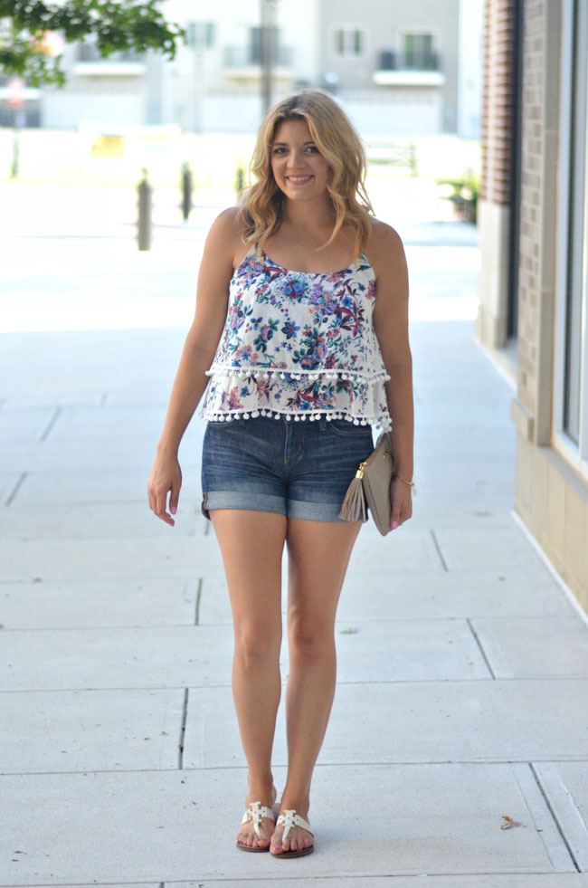cute casual summer outfit - floral print pom pom tank, denim shorts, tory burch sandals | www.fizzandfrosting.com