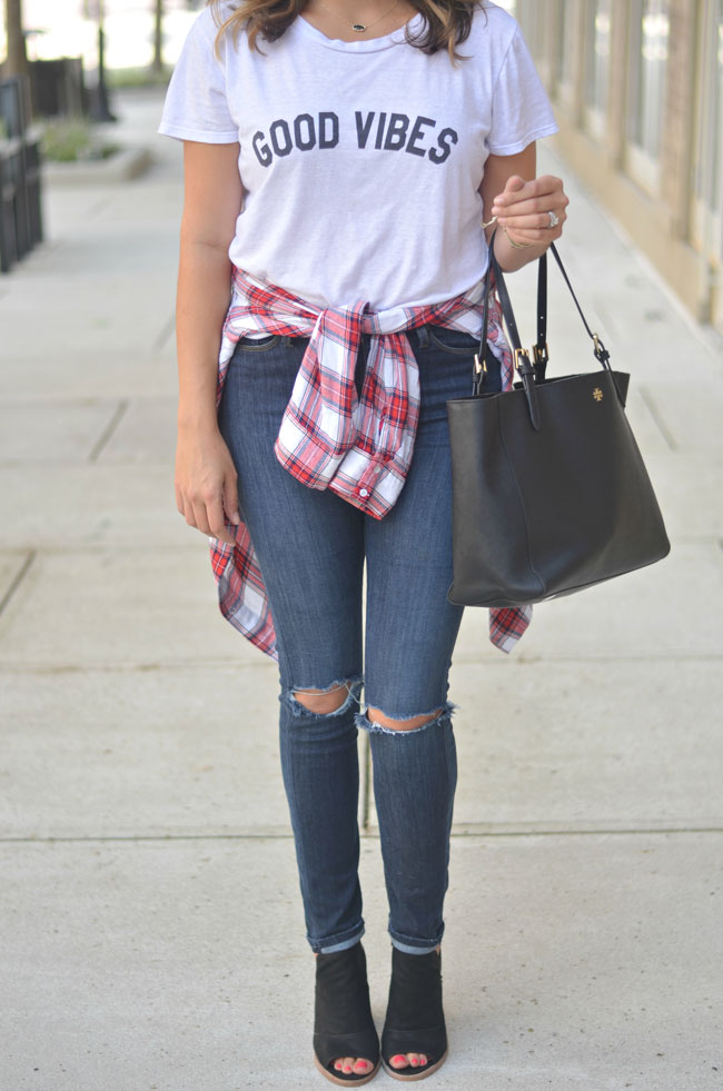 perfect weekend fall outfit - good vibes tee, red plaid top at waist, distressed skinny jeans, peep toe booties | www.fizzandfrosting.com