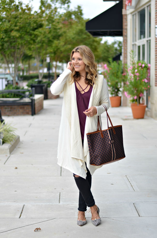 winter white long cardigan with burgundy wrap top, black jeans, and animal print lace-up flats | www.fizzandfrosting.com