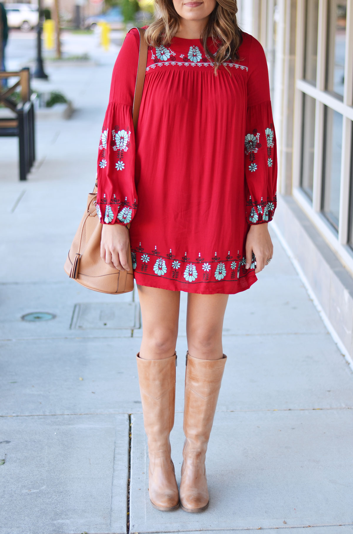 what to wear with a red dress - red embroidered mini dress with nude heeled boots and a nude buck bag | www.fizzandfrosting.com