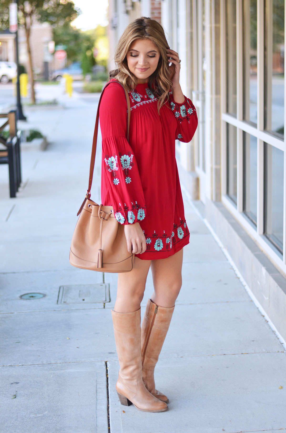 boho fall style - red embroidered mini dress with tan boots and a tan bucket bag | www.fizzandfrosting.com