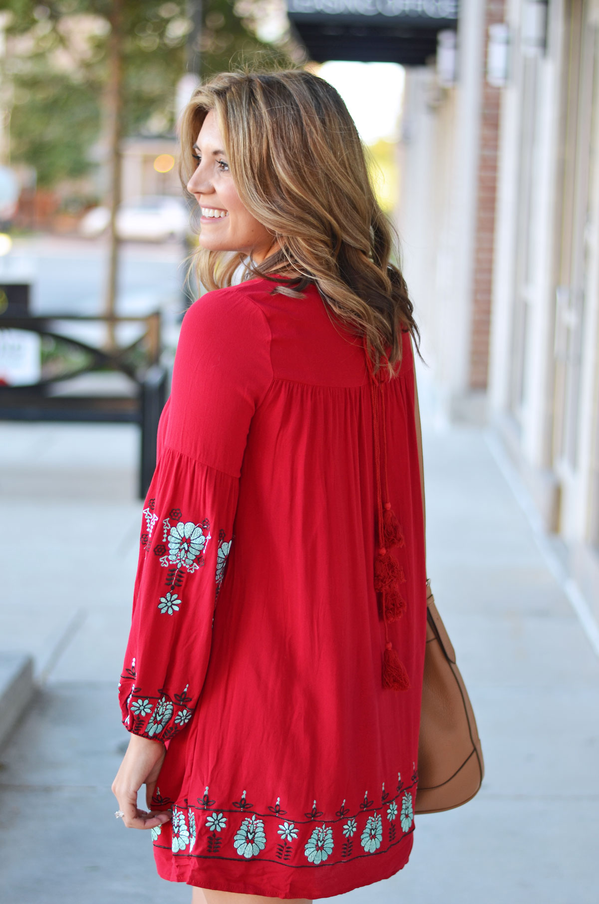 red embroidered mini dress with tassel tie detail | www.fizzandfrosting.com