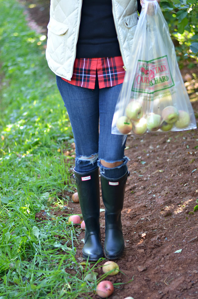 cute fall style - plaid top with a sweater and matte black hunter boots | www.fizzandfrosting.com