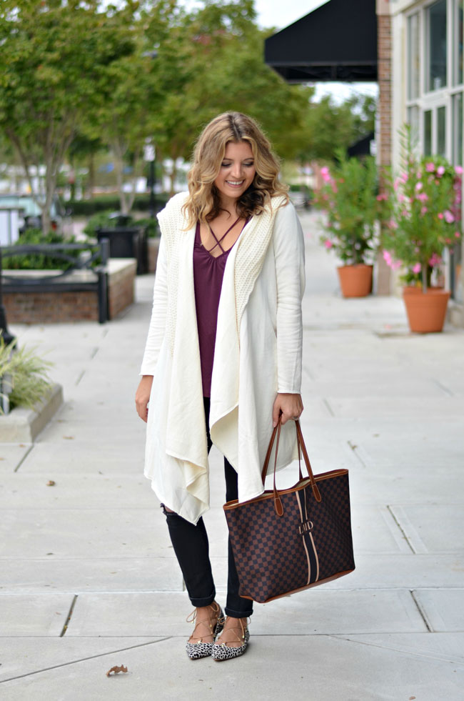 long draped cardigan for fall - long cream cardigan with criss-cross burgundy tee, black distressed jeans, animal print lace-up flats | www.fizzandfrosting.com