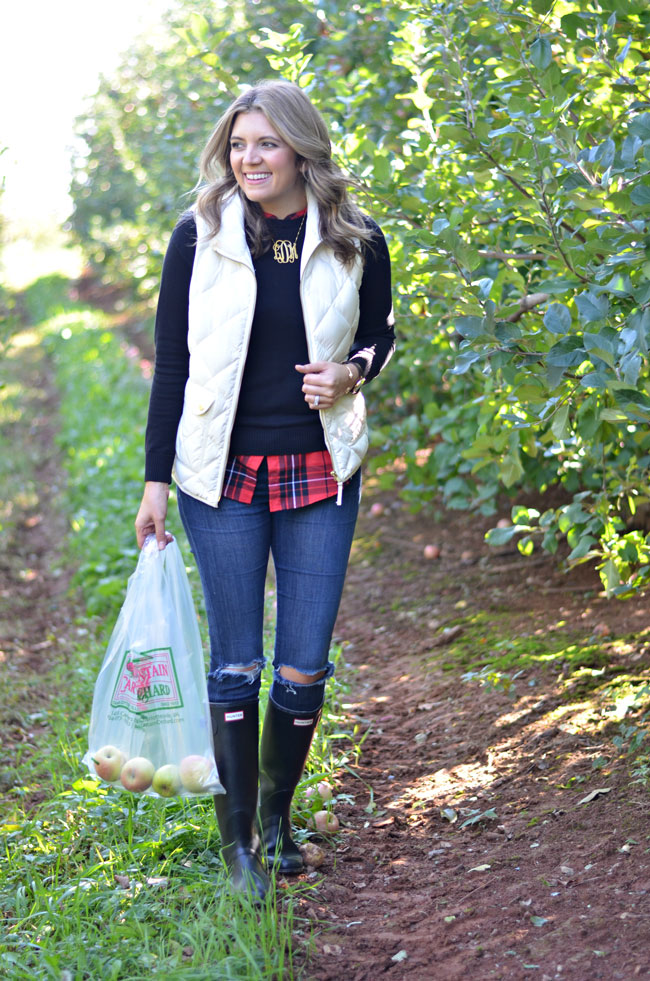 apple picking outfit - jcrew excursion vest with layered plaid top, distressed jeans and black hunter boots | www.fizzandfrosting.com